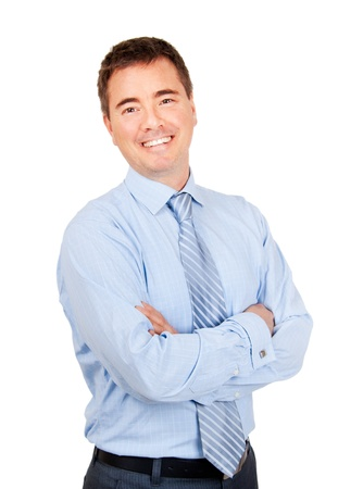 Smiling confident businessman with arms crossed on isolated background