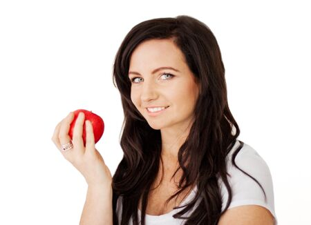 Beautiful young brunette lady about to eat a delicious red apple