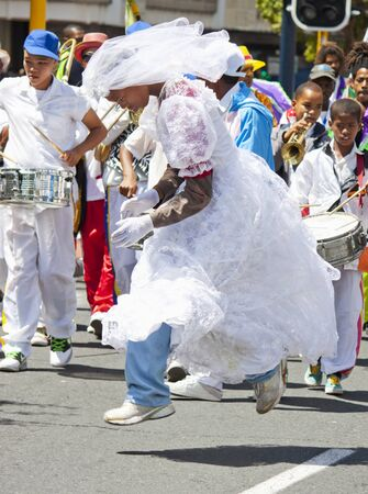 Man dressed as bride leaping to the beat of the carnival music Editorial