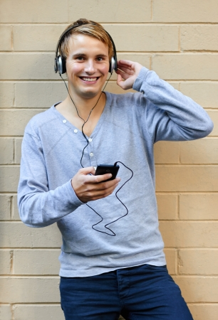 Young male listening to music on phone Stock Photo