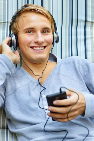 Teenager relaxing and listening to tunes