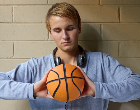 Young cool male thinking of basketball game photo
