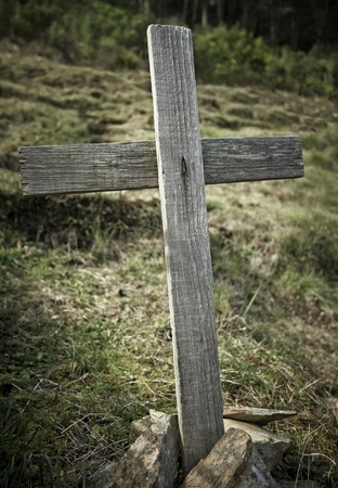 An old wooden cross marking a grave