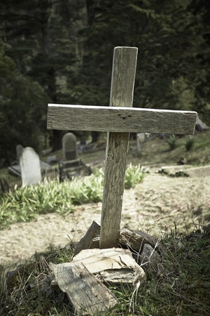 Solo wooden cross in old cemetary