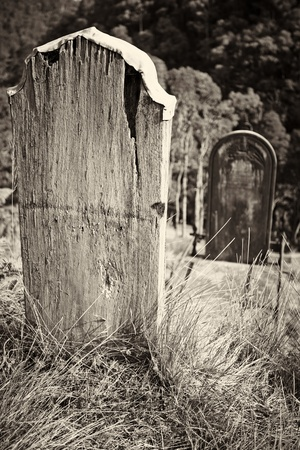 An old wooden grave headstone