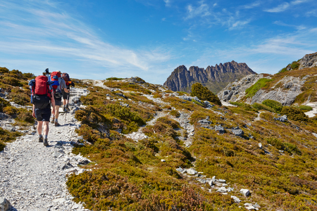 ruck sack: Hikers on the Overland Trail in Cradle Mountain National Park, Tasmania Stock Photo