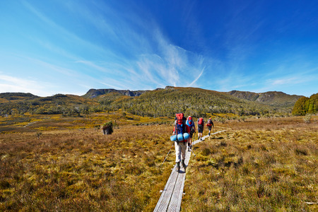ruck sack: Hikers on Overland Trail in Tasmania, Australia Stock Photo