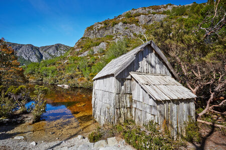 Old wooden hut by lakeside in Cradle Mountain Lake St  Clair National Park