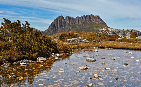 Stunning Cradle Mountain with tarn in foreground, Tasmania, Australia Stock Photo
