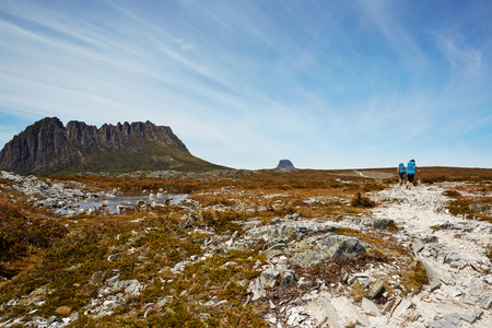 windswept: Windswept hikers on the desolate Overland Trail, Tasmania