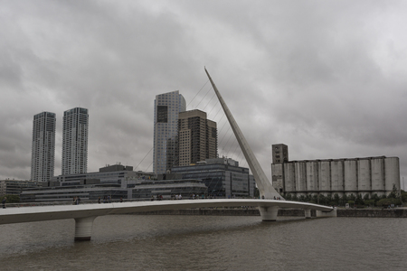 An overcast industrial version of Puente De La Mujer Bridge (Womens Bridge) in Buenos Aires Argentina