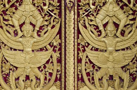 sculpture of thai temple window photo
