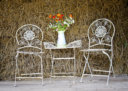 White iron chairs and table in the barn photo