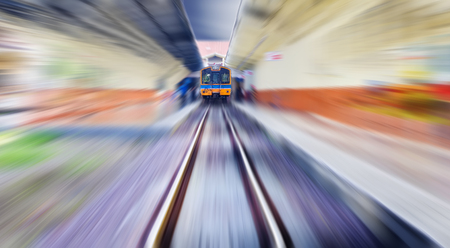 Vintage high speed train take off from station
