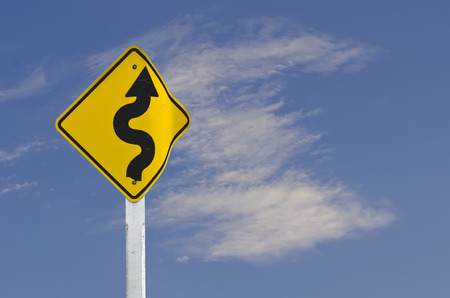 Winding Road Sign with blue sky