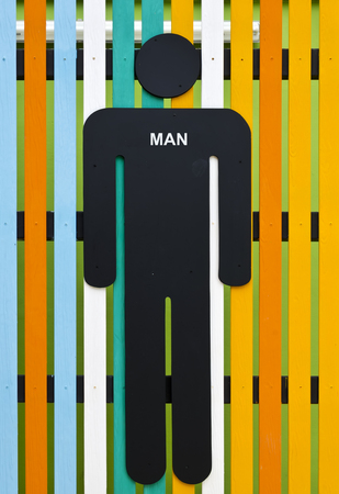 Man restroom sign on colorful wooden photo