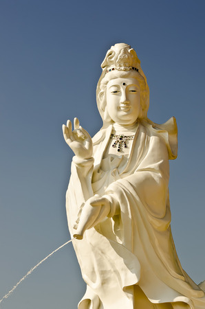 chinese holly: Statue of Guan Yin (goddess of mercy), Buddhism symbol