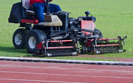 mowing grass: Mowing grass in a football stadium