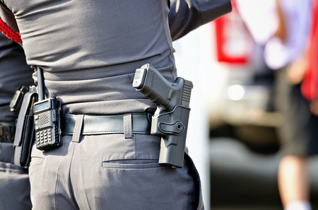 safety officer: Police man with the gun Stock Photo