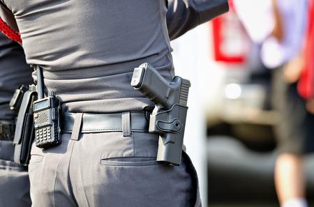 Police man with the gun Standard-Bild