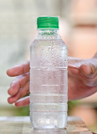 purify: Cool purify drinking water in a clear bottle.
