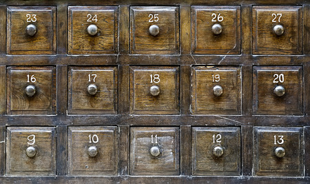 office stationery: Vintage wooden drawers with number Stock Photo