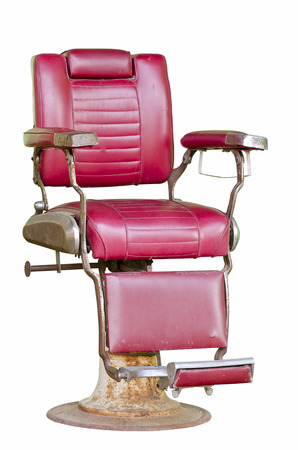 barber: Old barber chair isolated on white background.