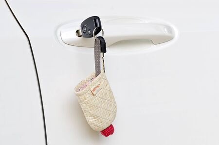 Car keys left in a lock of the white car