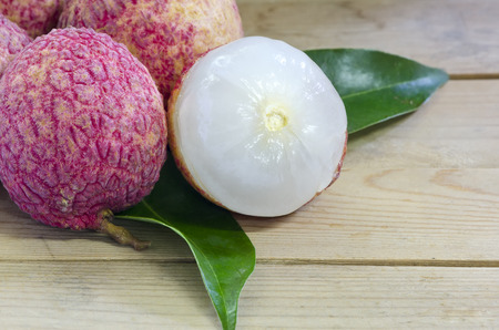 litchi: Fresh Lychee or Litchi with leave on wood background.