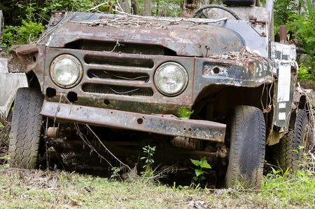 junk yard: Broken and  rusty  car in the junk yard