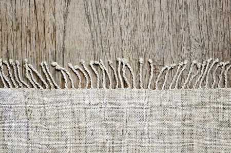 relate: Natural fibers  plate  mat on wooden table background.