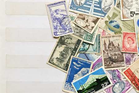postage stamp: Used stamps mail of  different countries on the book collecting stamps page.
