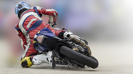Unidentified rider in motorcycle racing with soft background. Archivio Fotografico