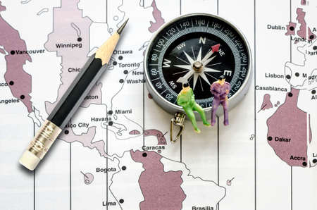 map pencil: Compass and pencil put on the map background. Stock Photo