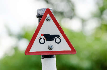 danger ahead: Motor vehicles traffic sign in  nature background. Stock Photo