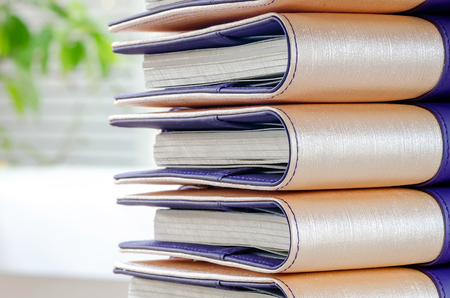 note books: Stack of note books in nature light and background. Stock Photo