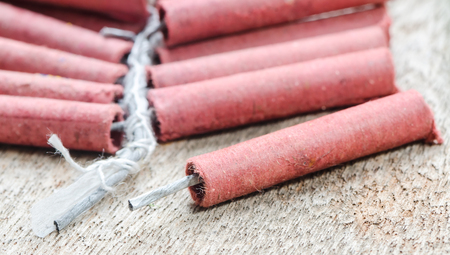 Firecrackers on wooden background.Shallow DOF. 免版税图像