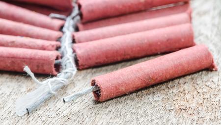 Firecrackers on wooden background.Shallow DOF. Standard-Bild