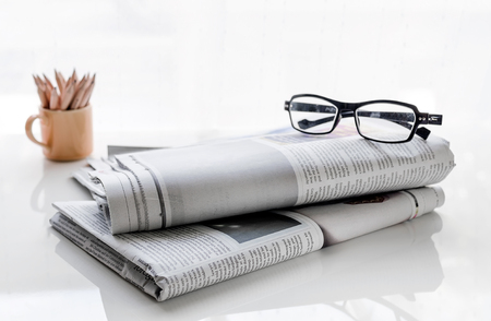 news paper: News paper on white background,soft focus.