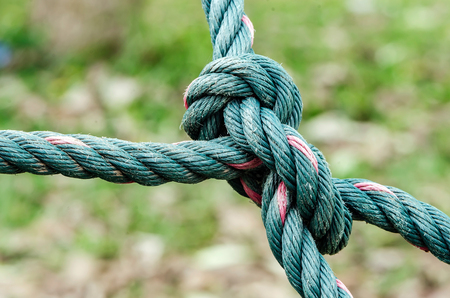 rope: Old ropes knot in nature light and background,close up view. Stock Photo