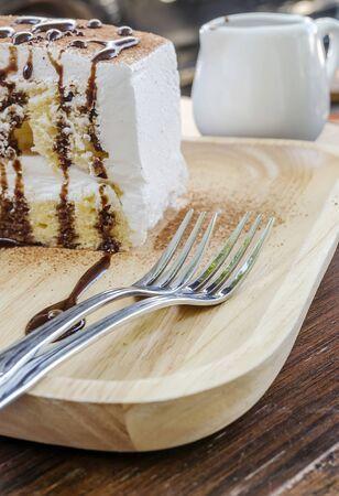choco: Chocolate cheese cake Dessert with Choco Shavings on wooden plate