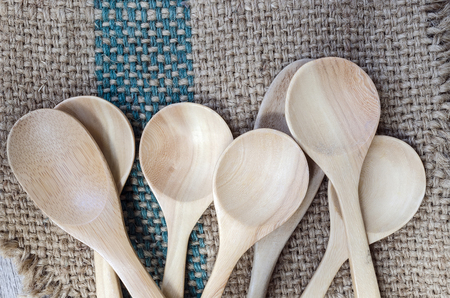 gunny: Wooden spoons on gunny bag background. Stock Photo