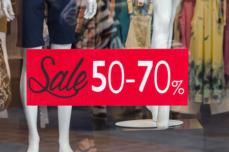 sale sign: window display with red sale sign Stock Photo