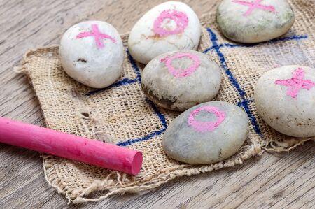 sackcloth: Stone Tic-tac-toe game on sackcloth