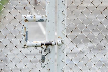 metal mesh: Rusty metal bolt on wire mesh door