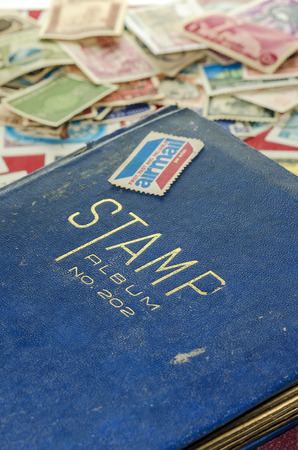 stamp collecting: Old stamp collecting book and used stamps mail Stock Photo