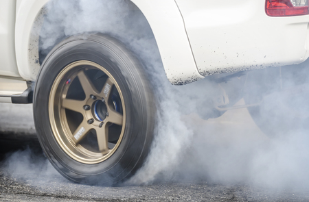 car burnout at a drag racing track Stock Photo