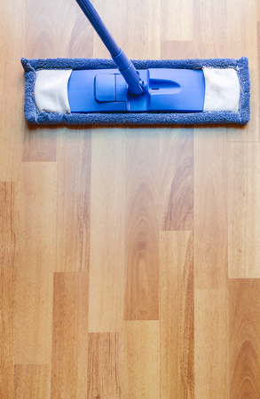 laminated: Modern style mop on laminated floor with copyspace