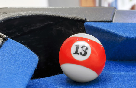 Pool ball number 13  on the corner pocket Stock Photo