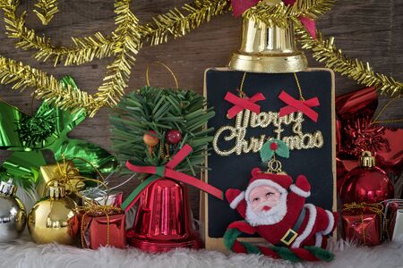 Beautiful Christmas ornament with Santa Claus and gifts for background. Stock Photo